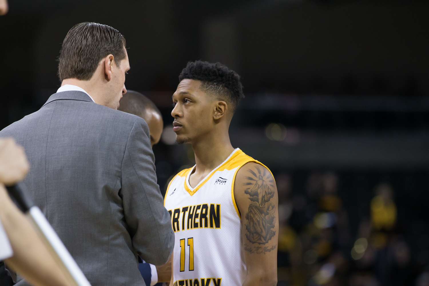Head Coach John Brannen talks to Mason Faulkner (11) during the game against Youngstown State.