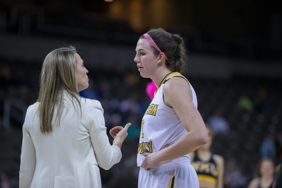 Head Coach Camryn Whitaker talks to Grayson Rose (10) during a timeout in the game against Oakland.