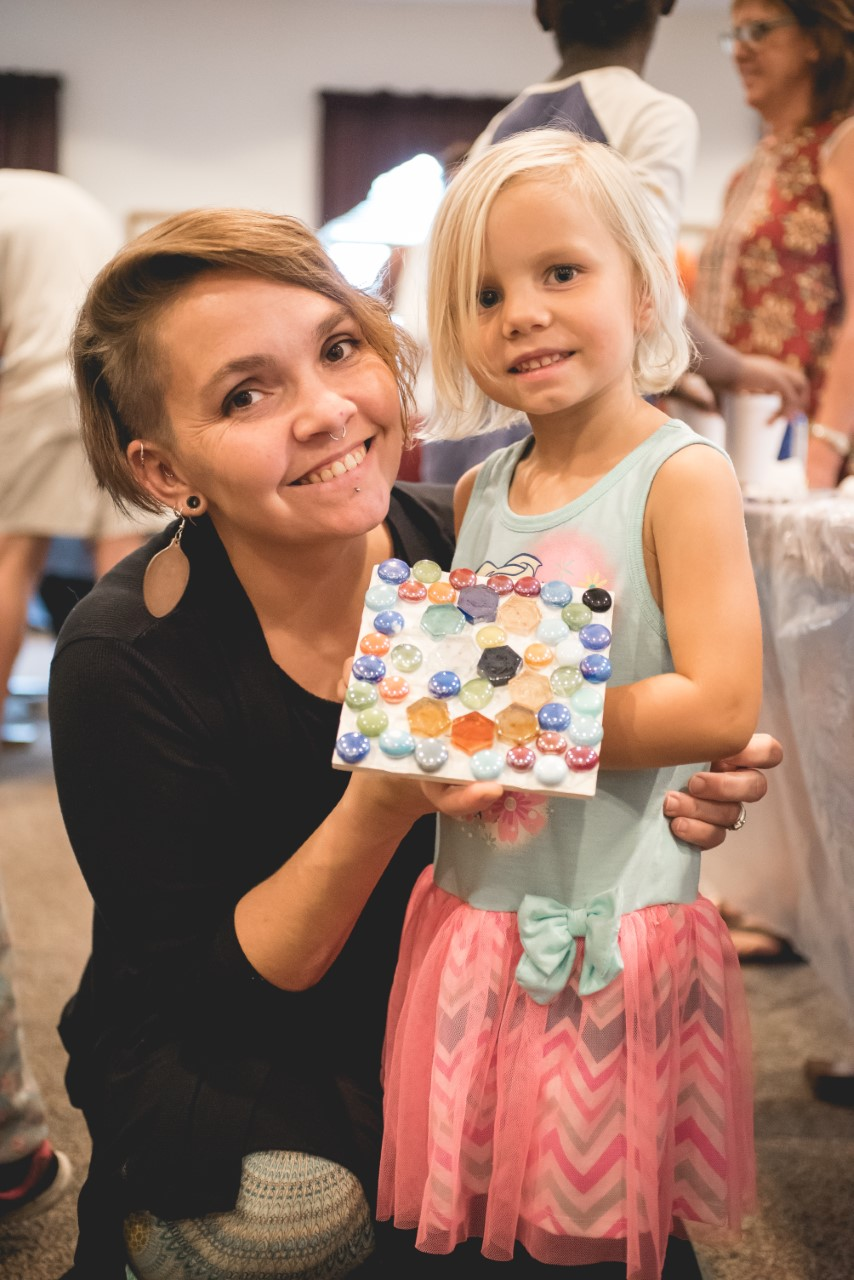 Rust-Jordan and her daughter, Stella, at a mosaic workshop she held for mothers to craft with their children with kindergarten readiness.