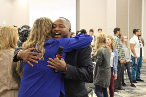 Nick Jackson hugs an attendee at NKUnity in the Student Union.