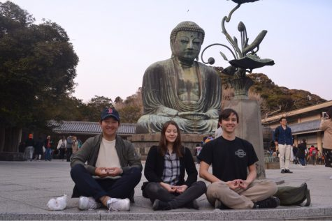 Austin Mayfield (left), Rika Hoffman (middle), and her cousin Shunya Minomo (right), posing in front of the Great Buddha in Kamakura, Japan.