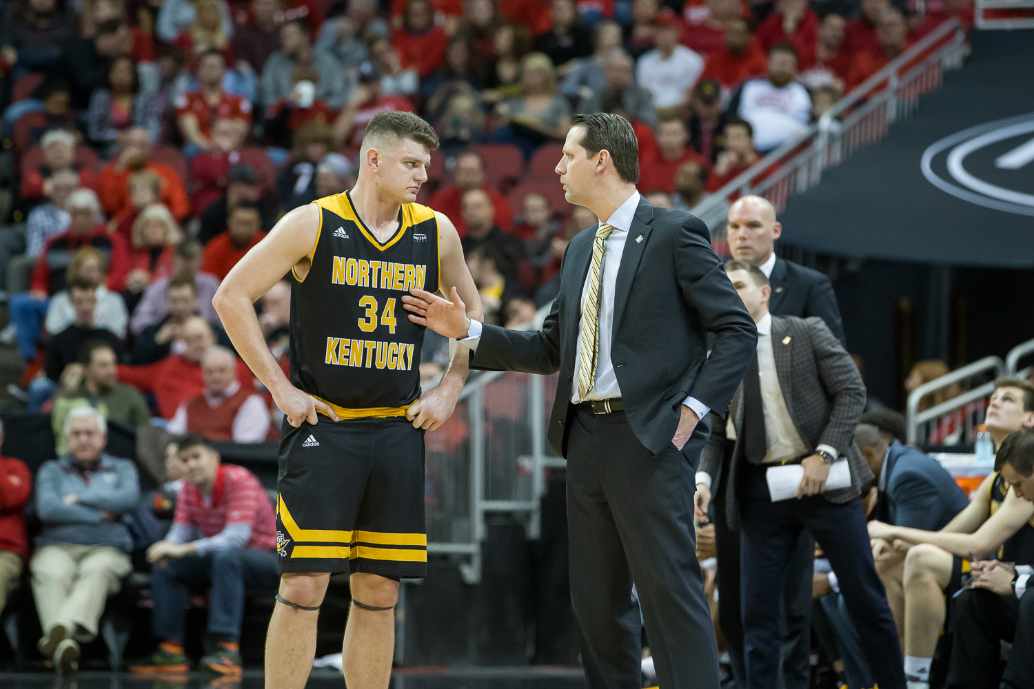 Drew McDonald (34) talks to Head Coach John Brannen during a free throw during the game against Louisville.
