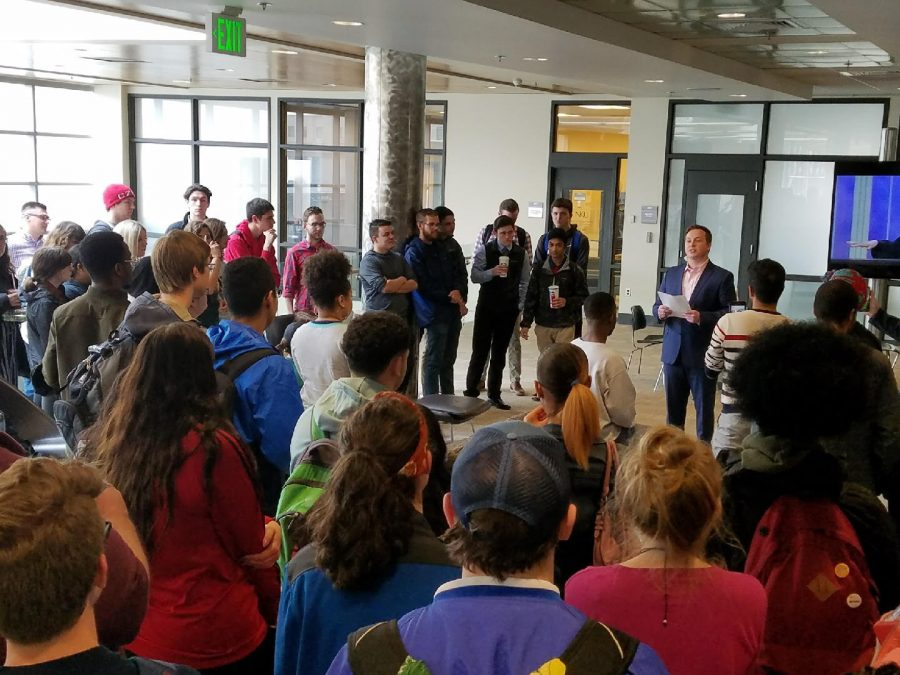 Chief Justice and election commissioner Hunter Poindexter announces results outside SGA offices March 30.