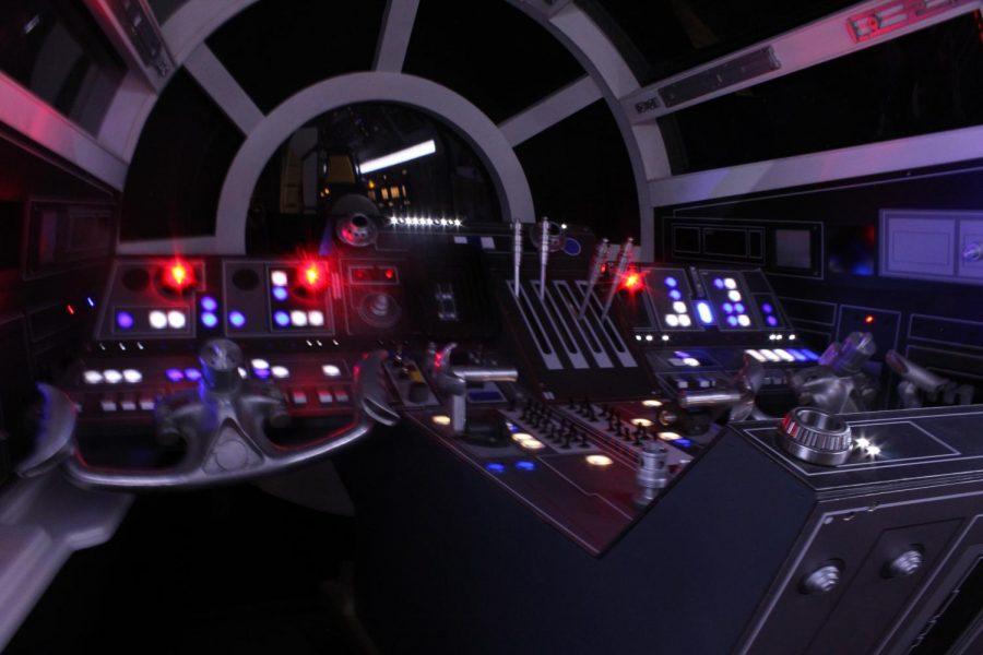 Inside the cockpit of the Millennium Falcon.