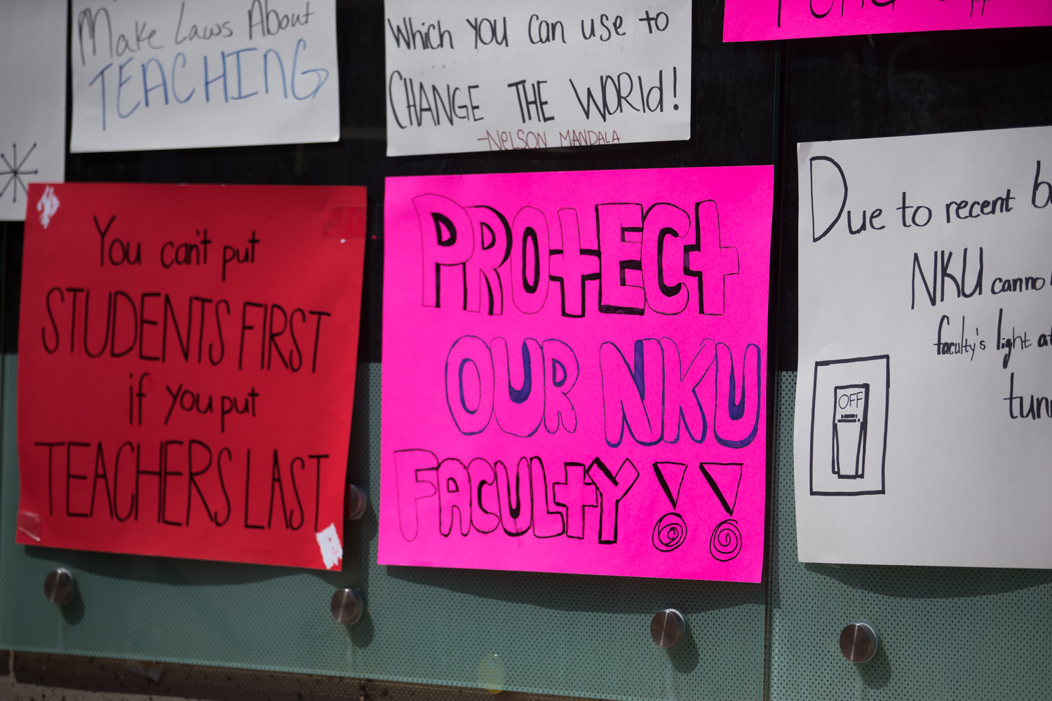 Signs hung on wall outside the Student Union on April 12.