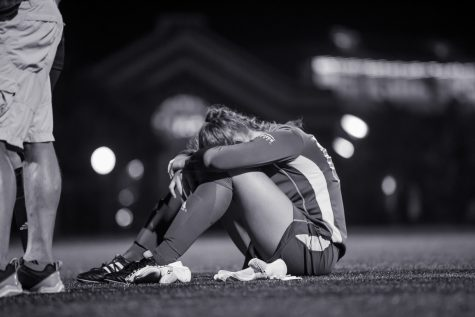 Keeper Emily Lohmann (00) reacts after letting in a goal during overtime in the game against UC.