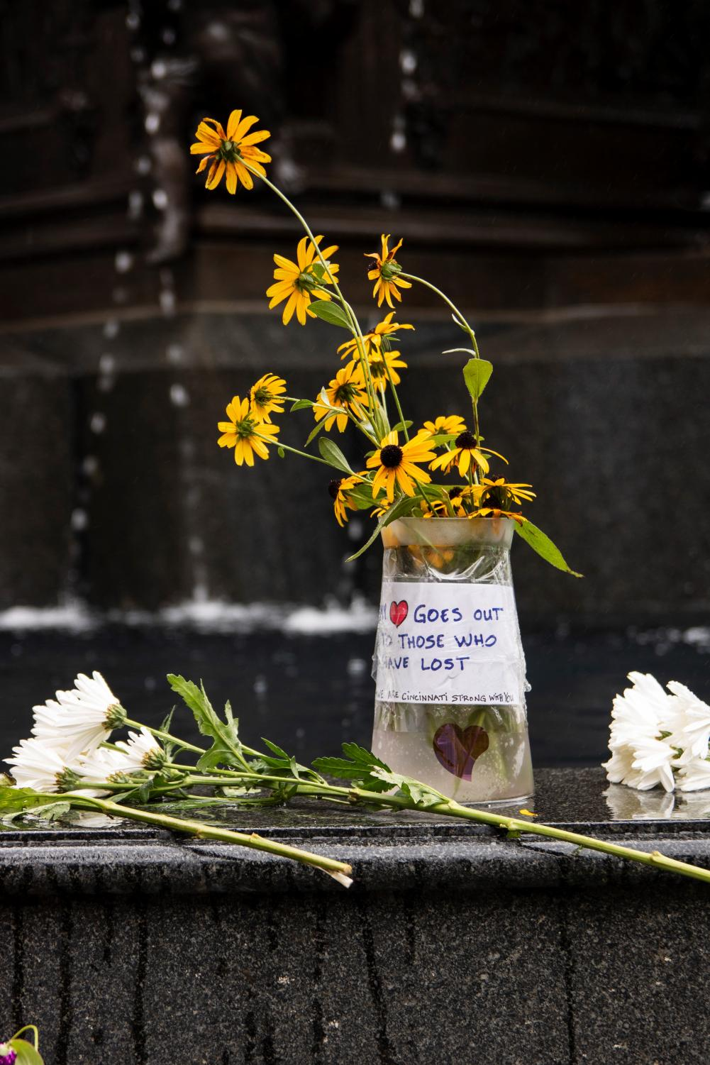 Flowers%2C+notes+and+other+tributes+lay+on+the+Tyler+Davidson+fountain.