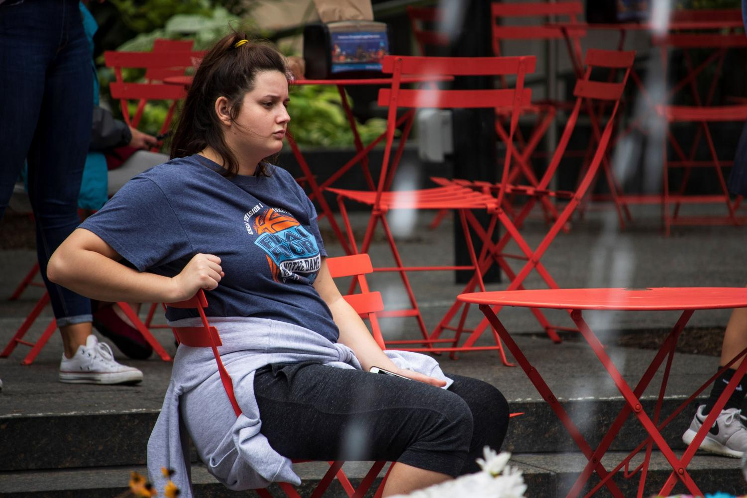 A+woman+sits+on+Fountain+Square%2C+which+was+closed+on+Sept.+6+after+a+shooting+incident+at+the+nearby+Fifth+Third+Center.
