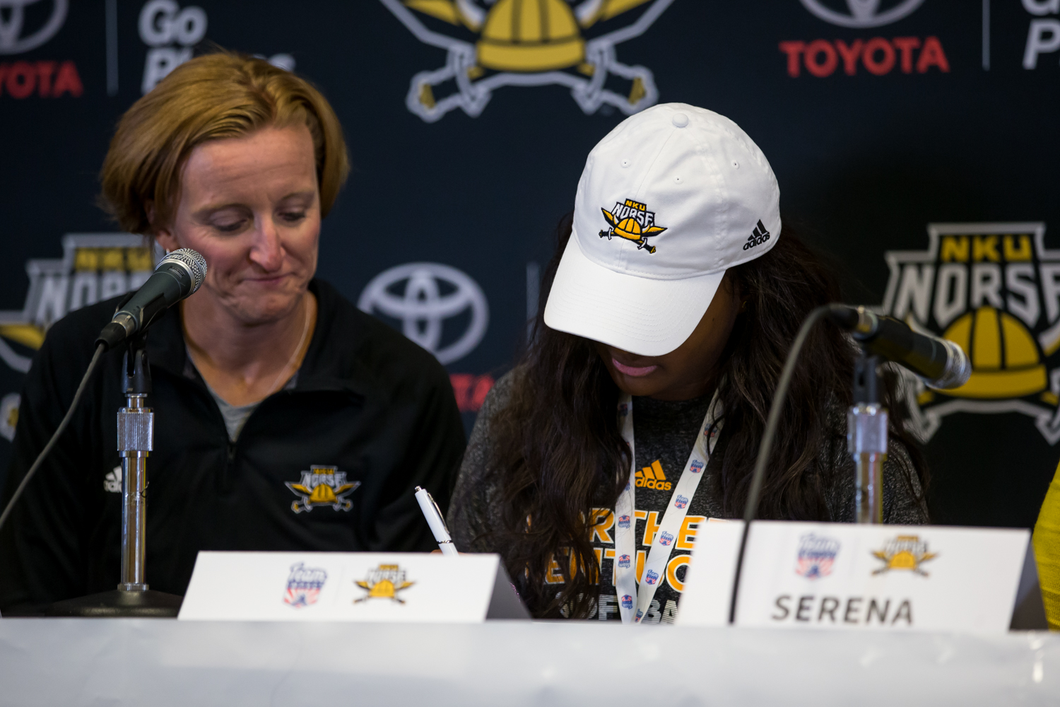 Head+Coach+Kathryn+Gleason+watches+as+Destiny+Owen%2C+a+member+from+team+IMPACT%2C+signs+to+become+a+member+of+the+NKU+softball+team.
