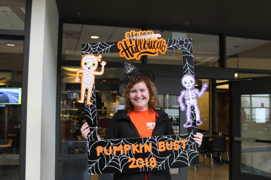 Sophomore Korbin Florer, sports business and finance double major, becomes wickedly cool as she helps with Activites Programming Board's Pumpkin Bust on Oct. 31, 2018.