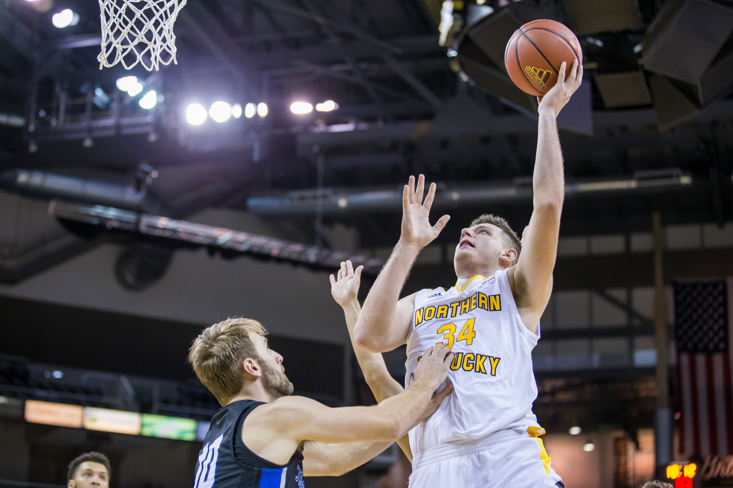 Drew McDonald (34) goes up for a shot during the game against Thomas More. McDonald had 14 points during the game.