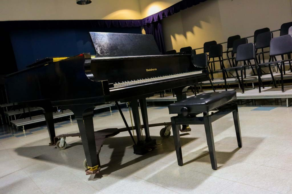 Music students have the ability to practice the piano in practice rooms.