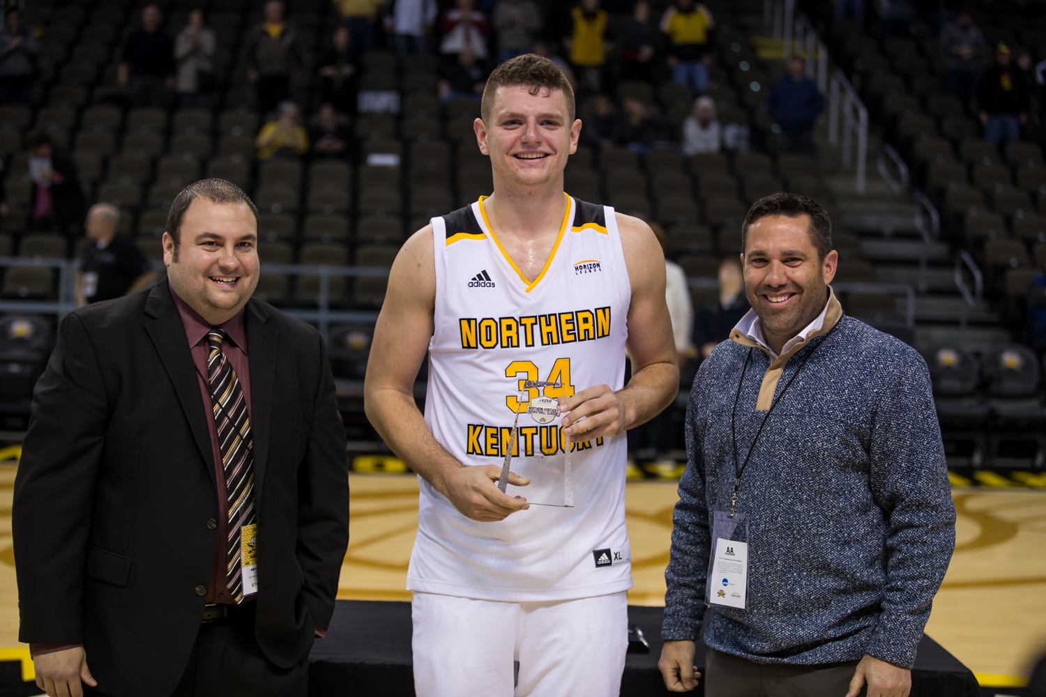 Drew McDonald (34) is recognized as the tournament's Most Valuable Player following the game against Coastal Carolina. McDonald had 31 points on the game.