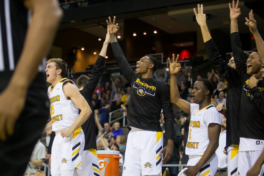 NKU players celebrate after a three point shot by Tyler Sharpe (15).