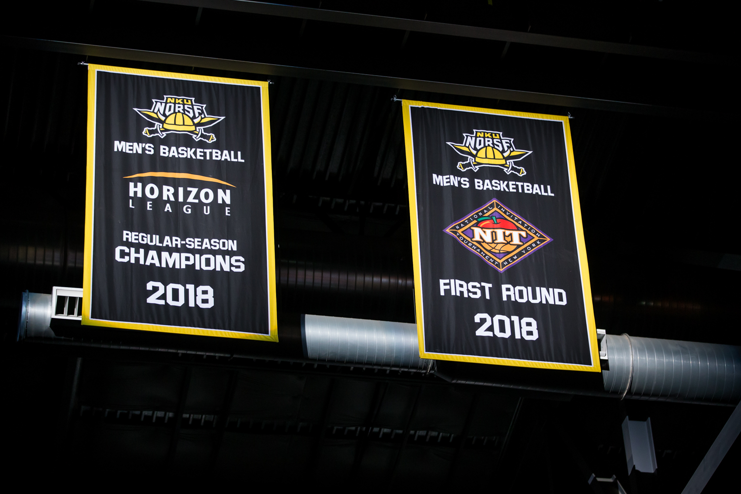 Banners+are+revealed+before+the+game+against+Wilmington.+The+banners+recognized+the+Norse+for+winning+the+Horizon+league+regular+season+as+well+as+their+appearance+in+the+NIT+Tournament.