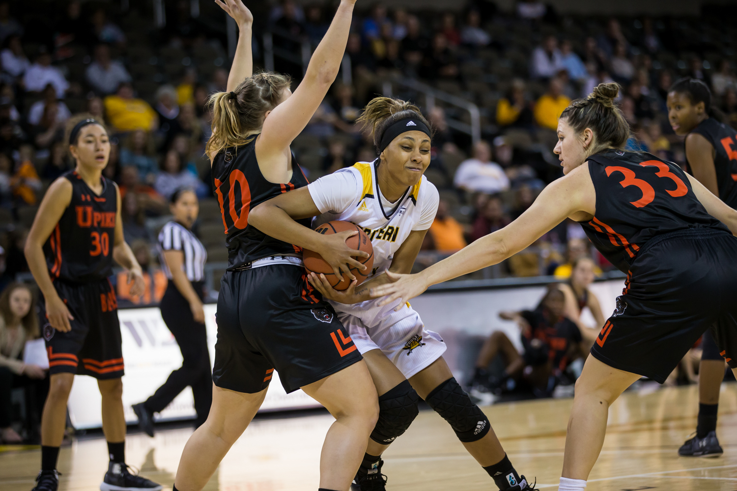 Samari Mowbray (5) fights to shoot during the game against University of Pikeville.