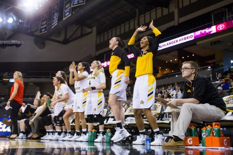 NKU Women's Basketball Players cheer after a point during the game against Green Bay. The Norse fell 81-61.
