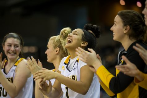 NKU players cheer after a point made during the game against Oakland. The Norse defeated Oakland 72-50.