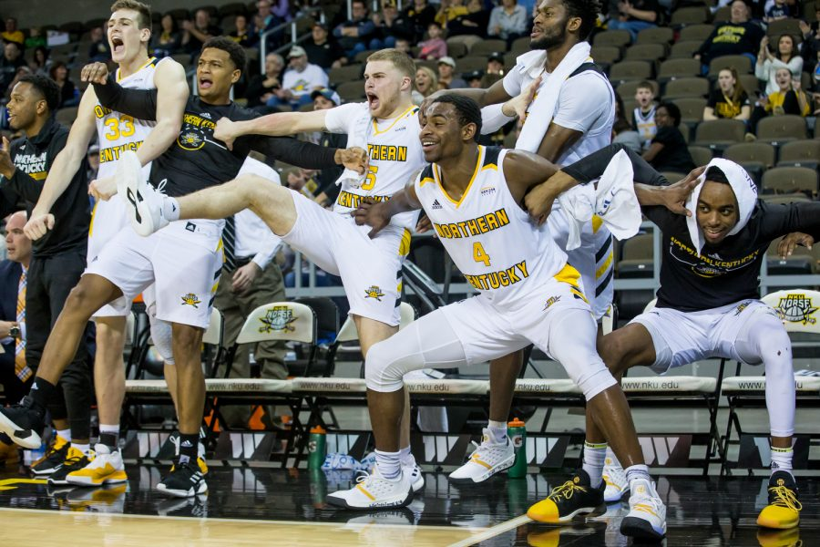 NKU players cheer after a dunk during the game against Detroit Mercy. The Norse defeated Detroit 97-65.