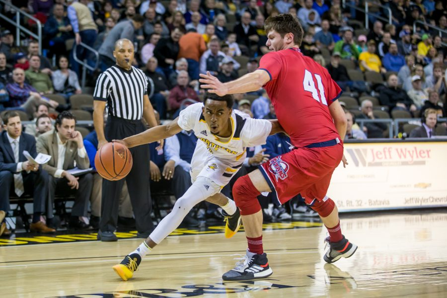Jalen Tate (11) fights past a Detroit Mercy defender. Tate shot 5-of-11 on the night and had 11 points.