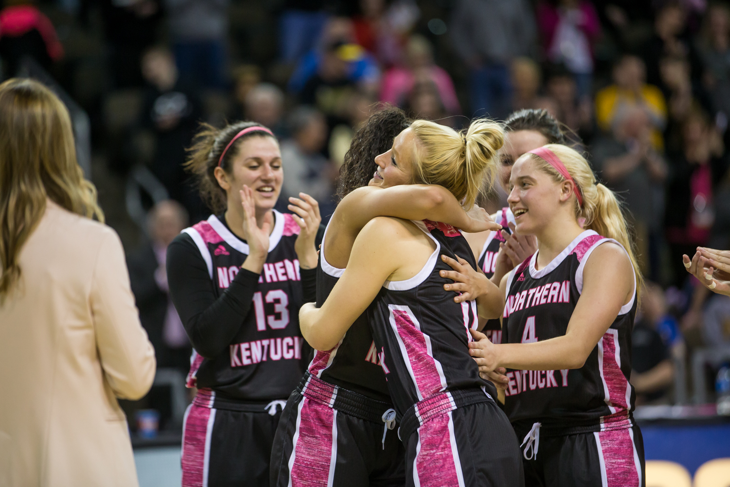 NKU+players+hug+Taryn+Taugher+%2811%29+on+the+court+after+the+game+against+Cleveland+State.+The+win+over+Cleveland+State+gives+them+a+6-0+winning+streak+at+home.