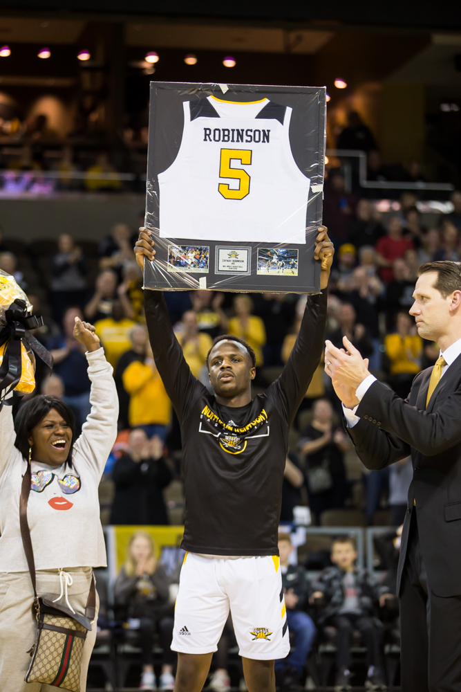 Zaynah+Robinson+%285%29+holds+up+his+framed+jersey+on+senior+night+before+the+game+against+Cleveland+State.