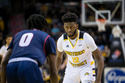 Trevon Faulkner (12) stares down Antoine Davis (0) during the Horizon League Tournament game against Detroit Mercy. Faulkner had 1 steal on the game.