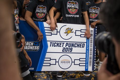 NKU players hold the sign showing their inclusion in the NCAA Basketball Tournament. NKU defeated Wright State during the final round of the Horizon League Tournament 77-66.