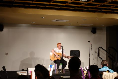A student shares an original song at the 6th annual Open Mic Night.