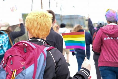 File photo. Students walk through NKU's campus to celebrate Pride Week.
