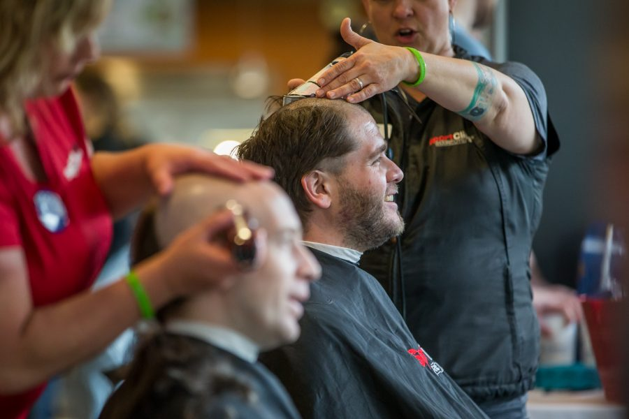 Students shave their heads to contribute to the St. Baldrick's foundation.
