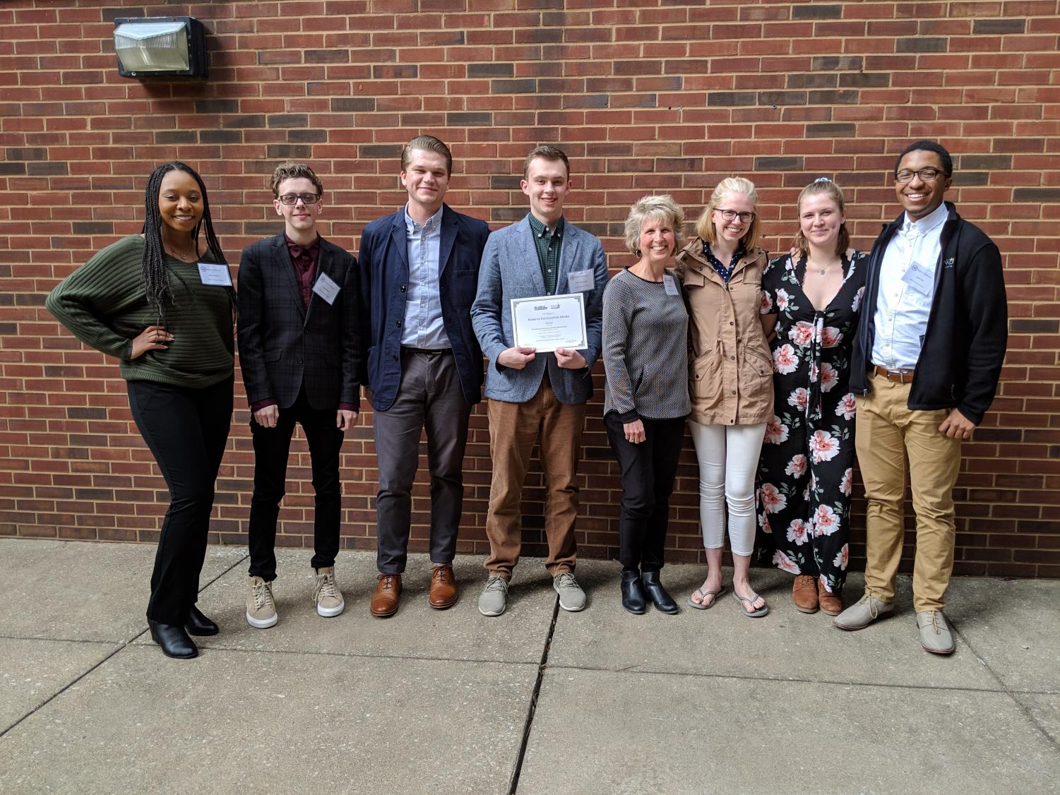 Northerner editors Sierra Newton, Kane Mitten, Billy Keeney, Sam Rosenstiel, advisor Michele Day, editors Natalie Hamren, Nicole Browning and Josh Kelly at the SPJ Mark of Excellence Awards, April 6, 2019.