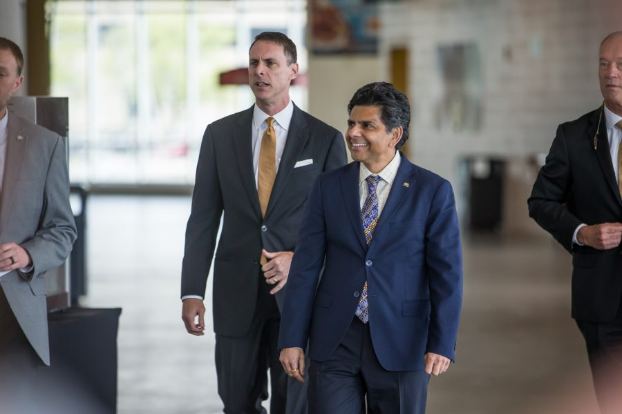 NKU+President+Ashish+Vaidya+walks+into+the+press+conference+alongside+the+new+Men%27s+Basketball+Head+Coach+Darrin+Horn.+Horn+most+previously+was+the+Associate+Coach+at+the+University+of+Texas.