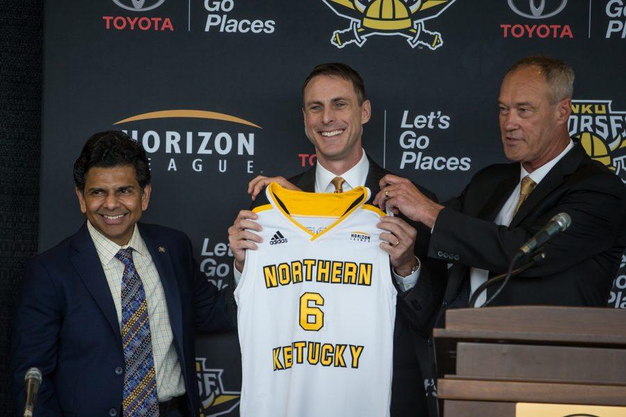 NKU President Ashish Vaidya (left) and Ken Bothof (right)stand alongside newly introduced Men's Basketball Head Coach Darrin Horn.