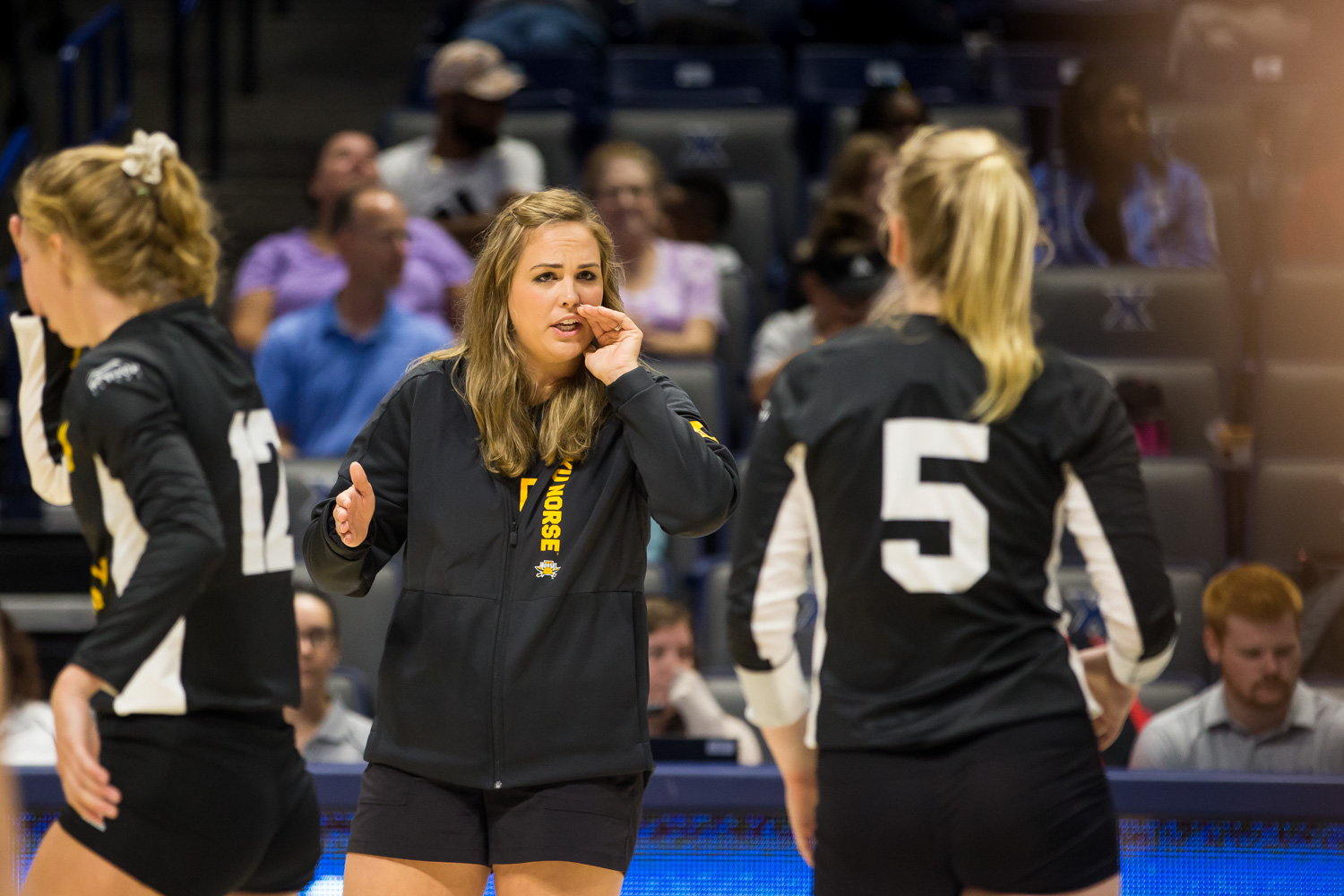 Women%27s+Volleyball+Head+Coach+Liz+Hart+talks+to+Miranda+Wucherer+%285%29++during+the+game+against+Xavier.+The+Norse+defeated+Xavier+taking+3+of+4+games.