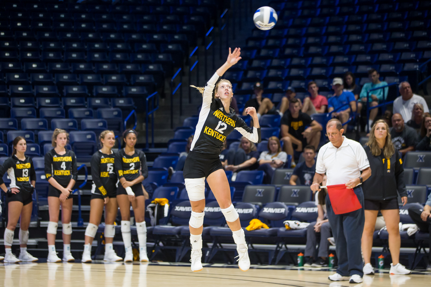 Laura+Crawford+%2812%29+goes+up+for+a+ball+during+the+game+against+Xavier.+The+Norse+defeated+the+Musketeers+and+won+3+of+4+sets.