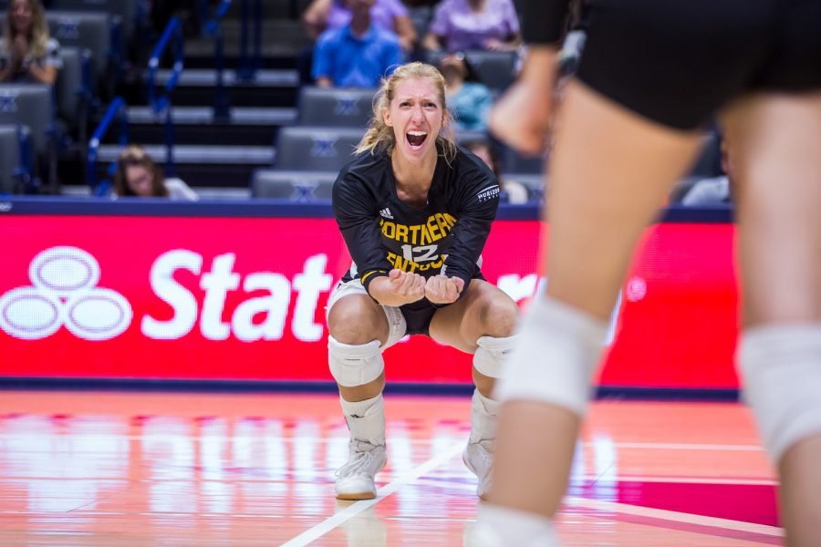 Laura Crawford (12) cheers after a point for the Norse during the game against Xavier. The Norse won 3 of 4 sets on the game and defeated Xavier.