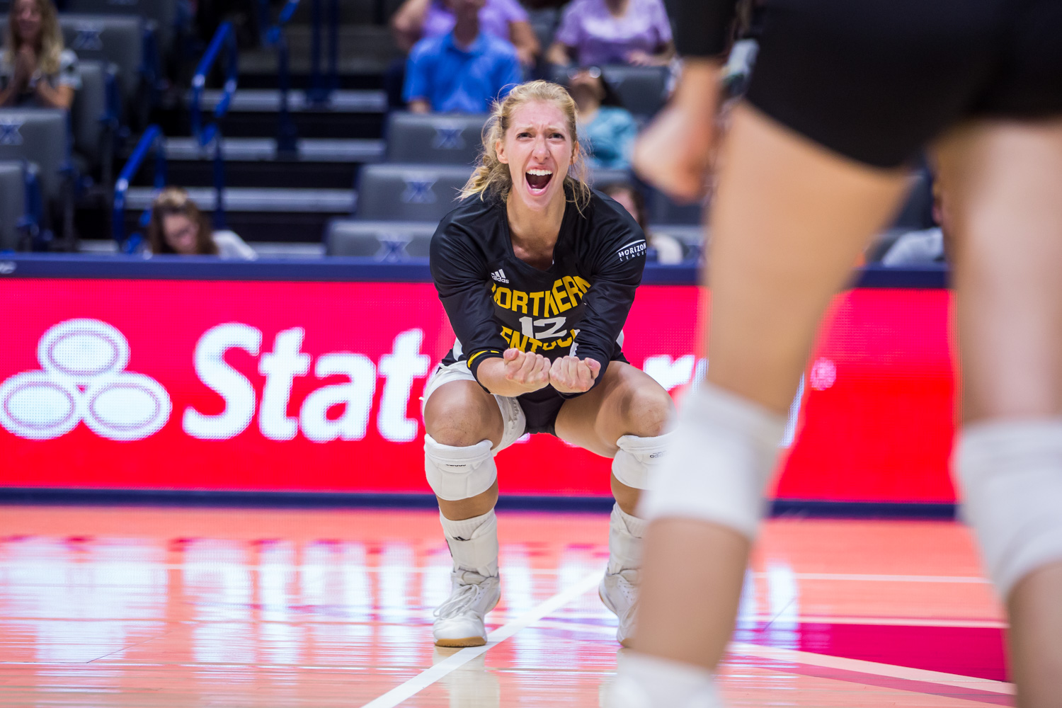 Laura+Crawford+%2812%29+cheers+after+a+point+for+the+Norse+during+the+game+against+Xavier.+The+Norse+won+3+of+4+sets+on+the+game+and+defeated+Xavier.