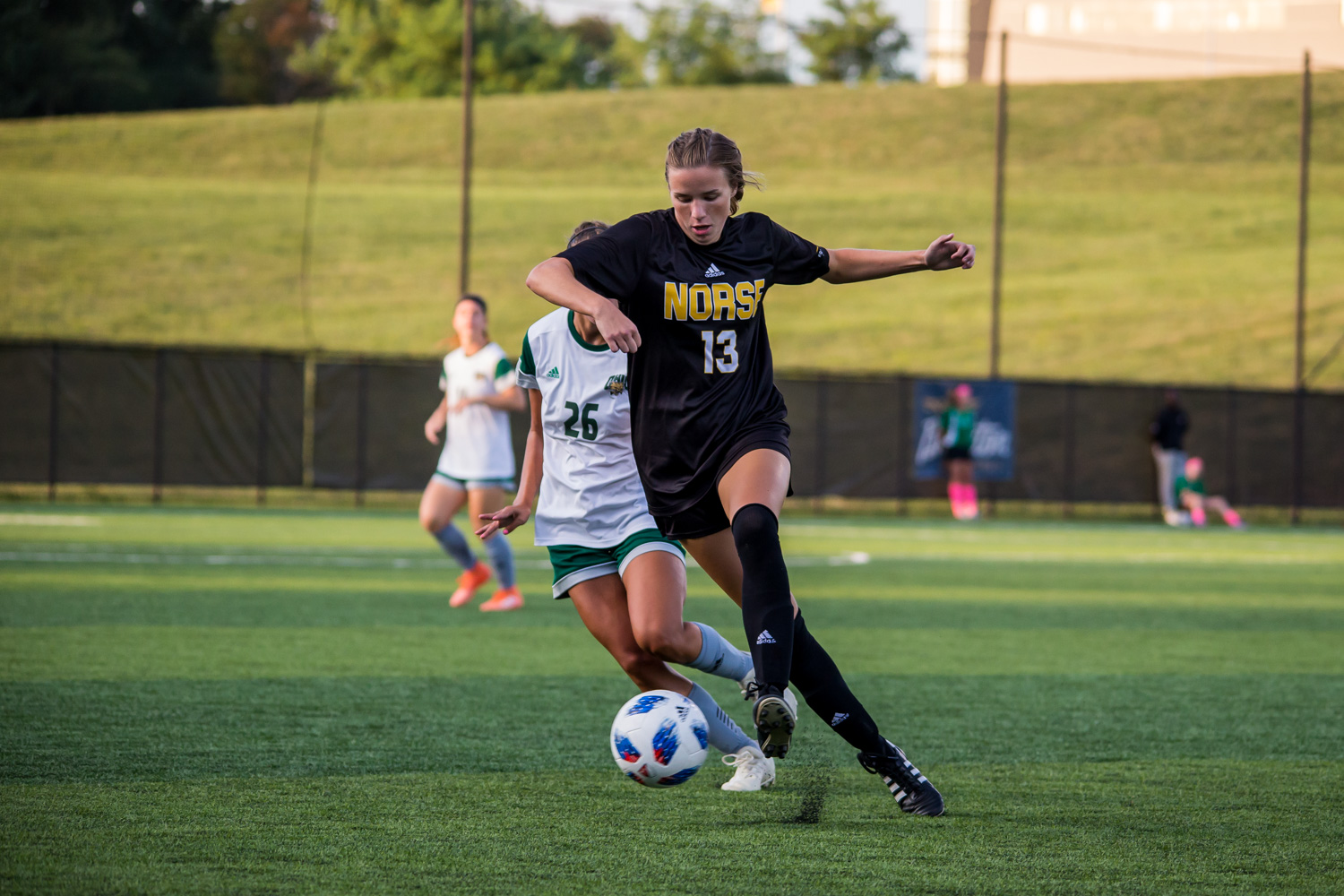 Shelby+Wall+%2813%29+dribbles+a+ball+down+the+field+during+the+game+against+Ohio+University.+The+Norse+fell+1-0+to+the+Bobcats+on+Sunday.