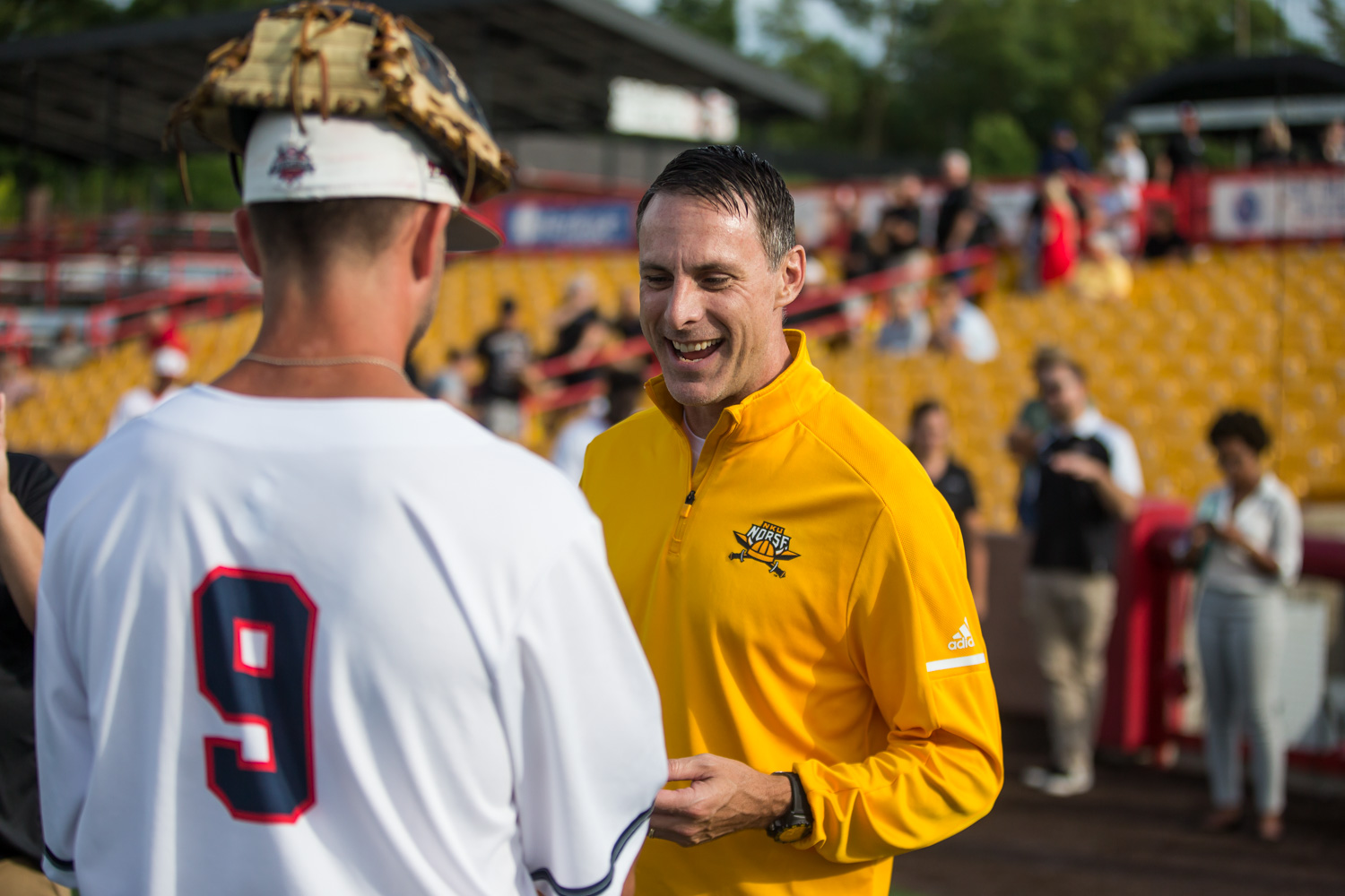 Men%27s+Basketball+Head+Coach+Darrin+Horn+receives+a+signed+ball+from+a+Florence+Freedom+player+on+NKU+night+at+the+Florence+Freedom+Baseball+Game.