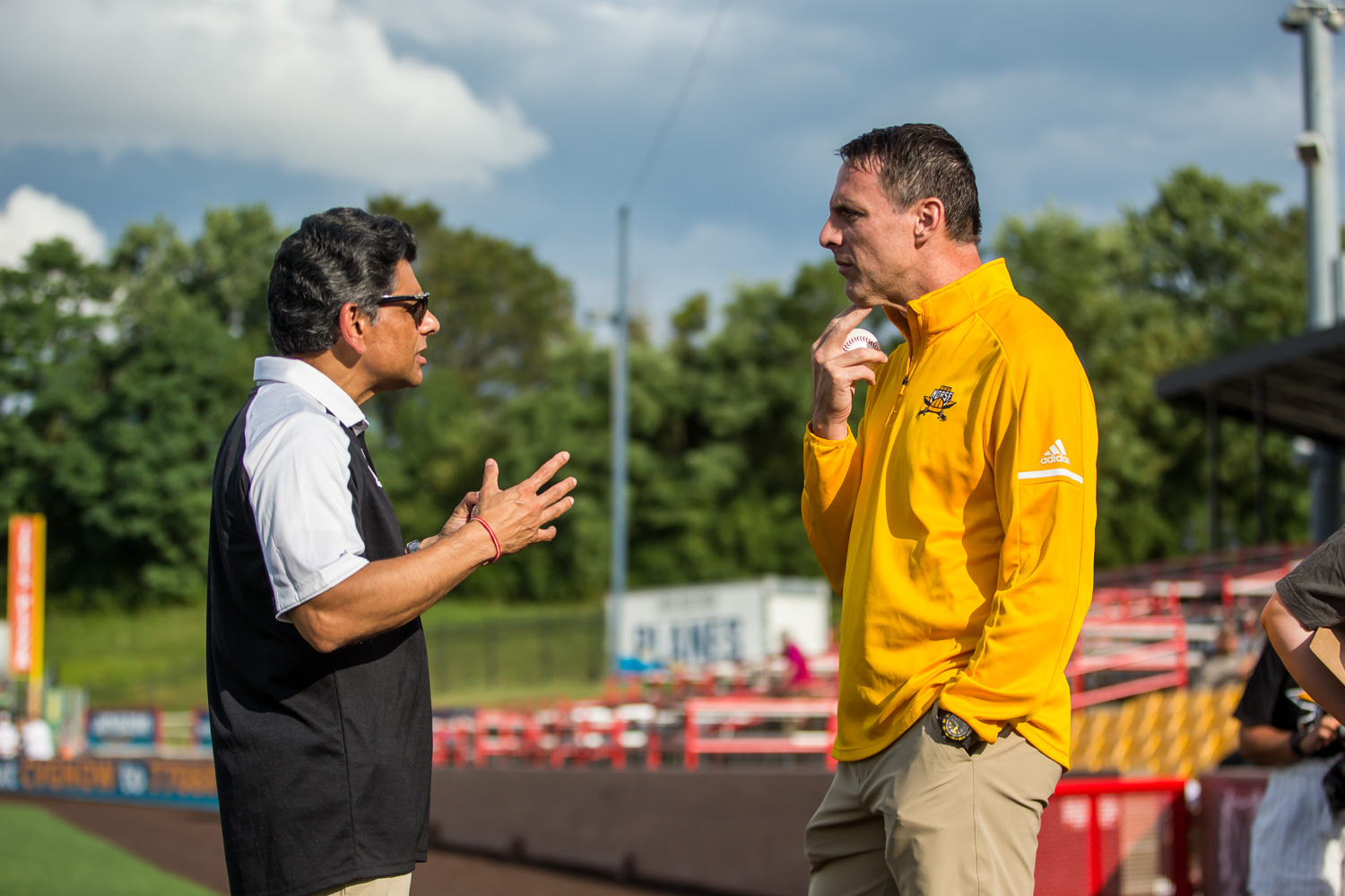 Men%27s+Basketball+Head+Coach+Darrin+Horn+%28right%29+talks+with+NKU+President+Ashish+Vaidya+%28left%29prior+to+the+first+pitch+at+the+Florence+Freedom+Baseball+Game.