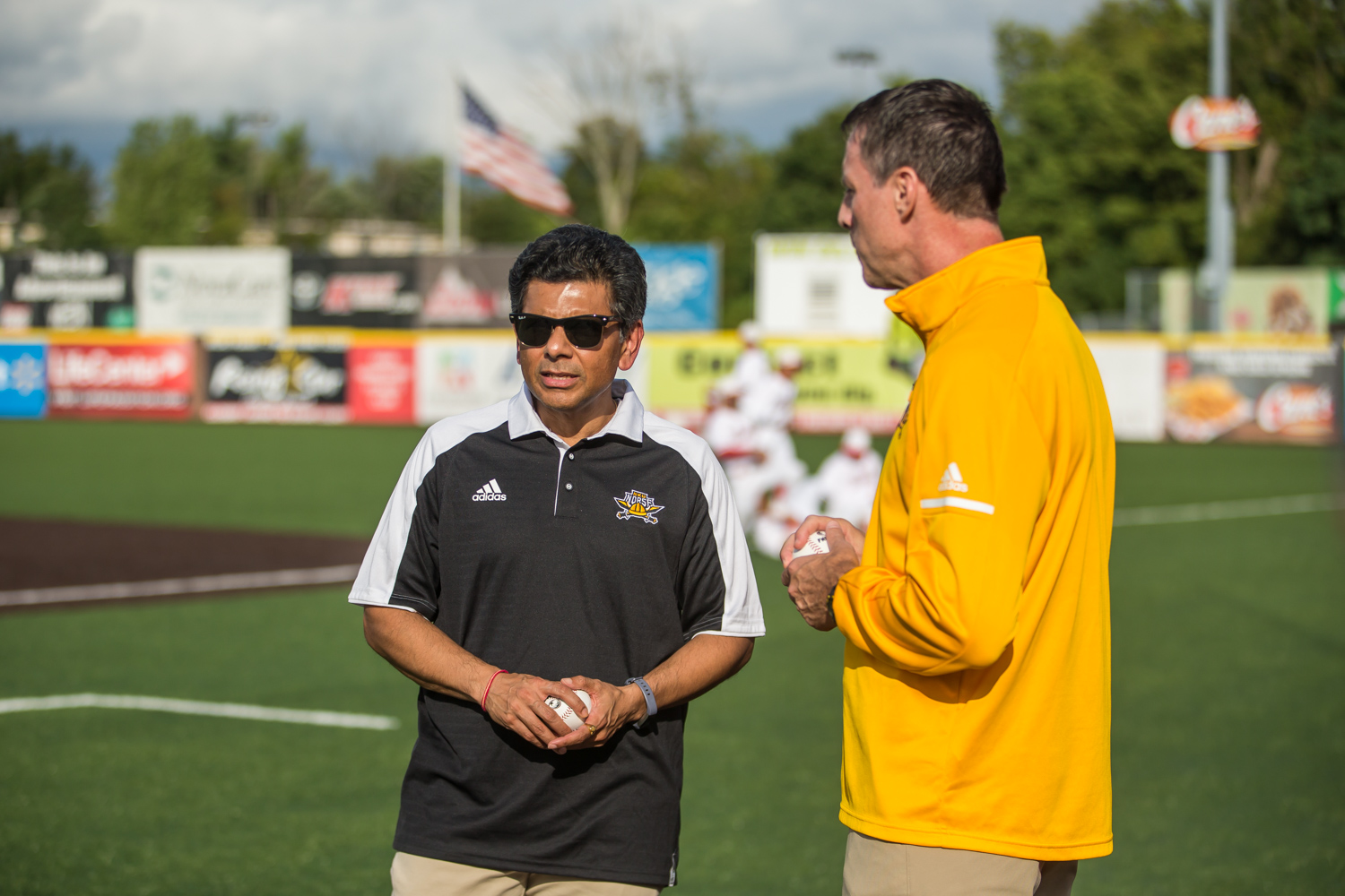Men%27s+Basketball+Head+Coach+Darrin+Horn+%28right%29+talks+with+NKU+President+Ashish+Vaidya+%28left%29+prior+to+the+first+pitch+at+the+Florence+Freedom+Baseball+Game.
