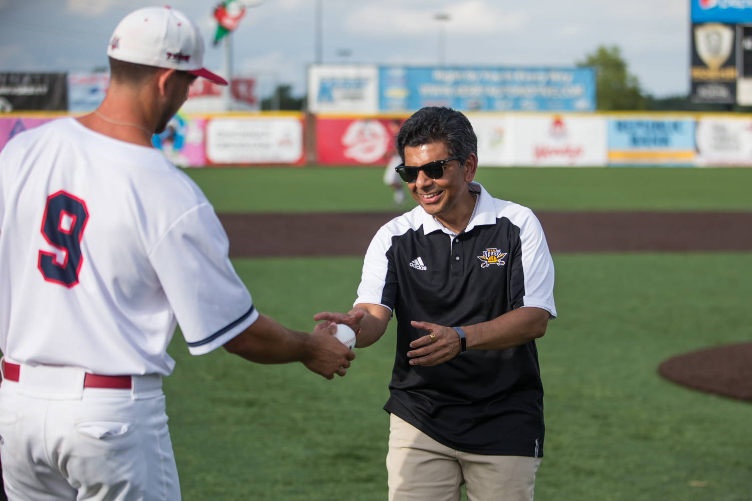 NKU+President+Ashish+Vaidya+receives+the+first+pitch+ball+from+a+Florence+Freedom+player.