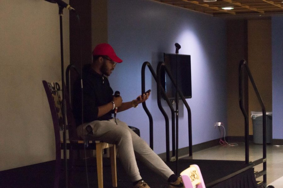 Trey Johnson performing an original piece at Poetic Justice's open mic night on Aug. 27.