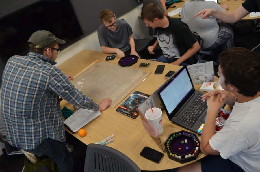 Members of Norse & Dragons play tabletop games in Founders Hall on Fridays.