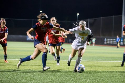 Ashleigh Cronin (5) dribbles toward the goal during the game against UIC. The Norse fell to UIC 1-0 on Saturday night.