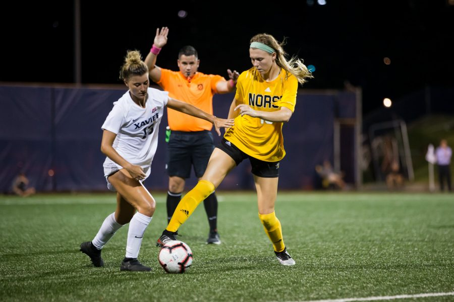 Kailey Ivins (15) fights to keep possession of the ball during Thursday's  match against the Musketeers. The Norse fell to Xavier 4-0.