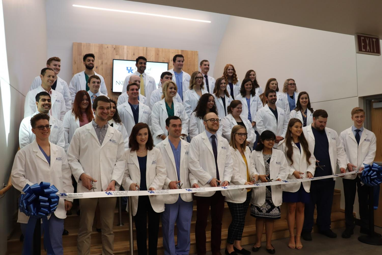 Students of the College of Medicine cutting the ribbon, marking the official opening of the college.