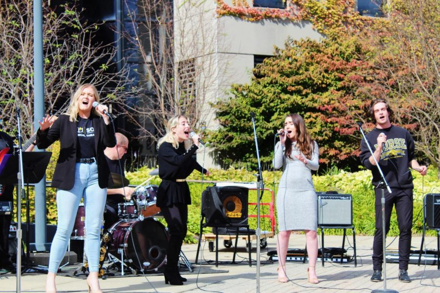 Sarah Hack, Victoria Avery, Kali Marsh and Logan Anthony perform a song from