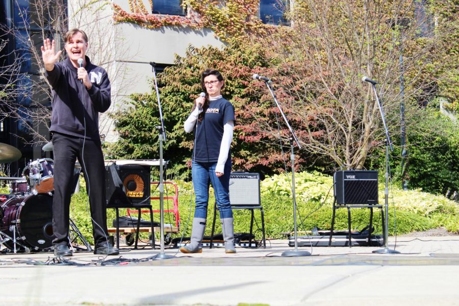Two faculty members perform a duet.
